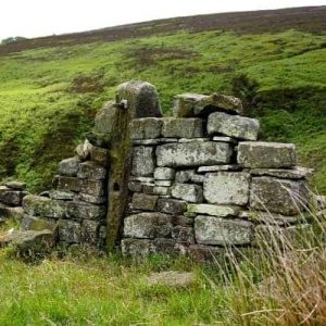 Stone wall and post